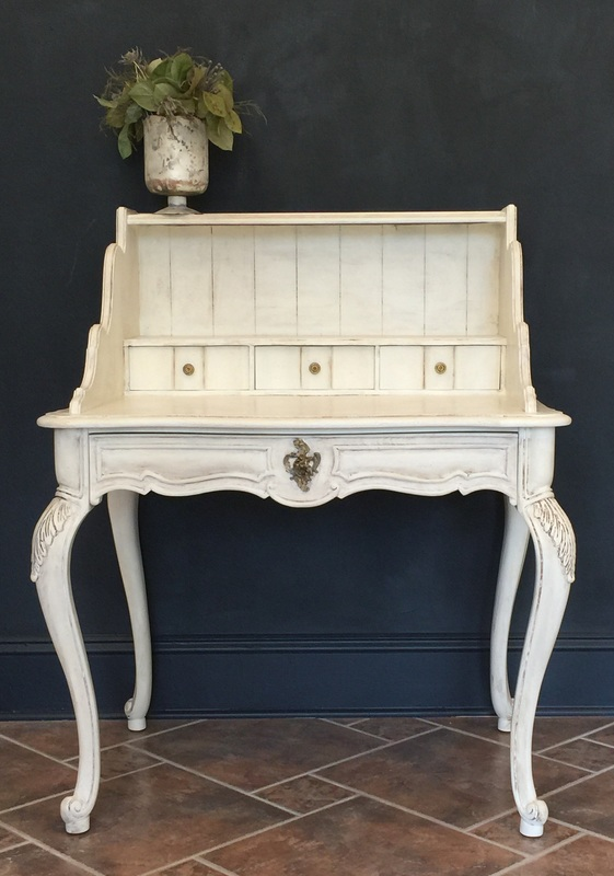old white secretary  desk painted with annie sloan chalk paint in old white, sealed with clear, dark and white wax.  www.creativefinishesstudio.com